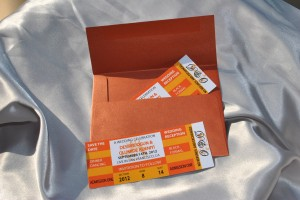 """Orange """"concert ticket""""  save the date cards in A2 envelope"""